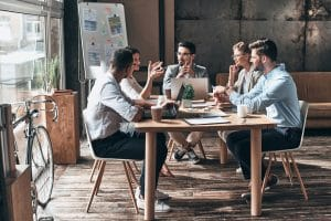 five-people-around-table-working-modern-office-